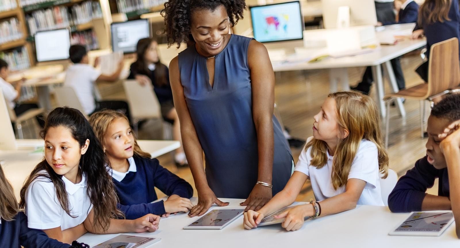 bigstock-Education-School-Teacher-Stude-125278622.jpg