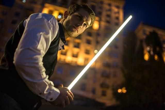bigstock-Handsome-guy-holding-a-lightsa-86324105.jpg